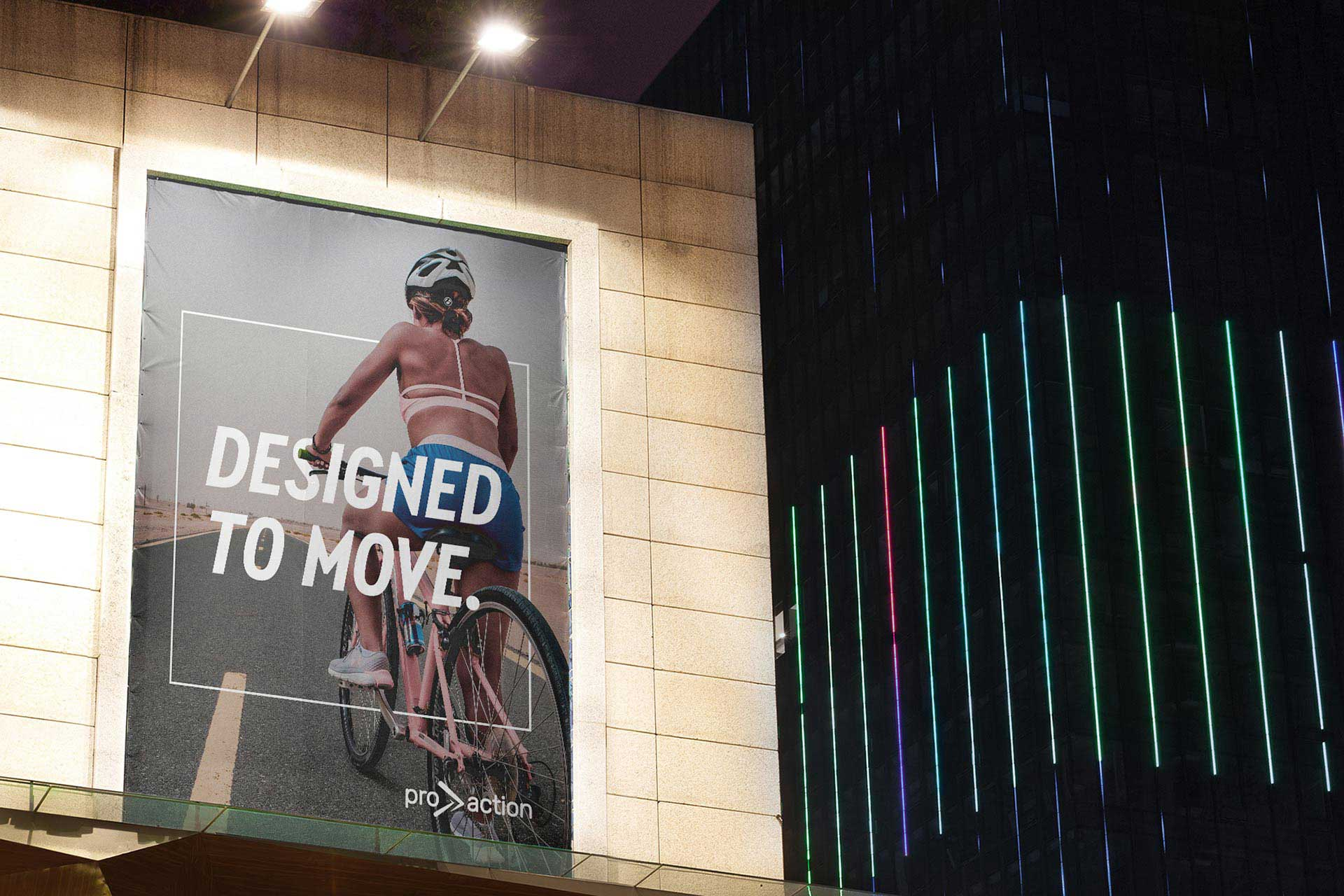 Pro action outdoor billboard advertising with girl on a cycle looking towards long road ahead